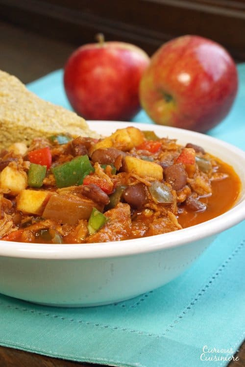 This Pulled Pork Chili uses fresh ingredients to give it a sweet and spicy flavor. You'd never guess it was an apple chili! | www.CuriousCuisiniere.com