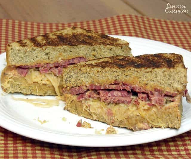 This classic grilled sandwich, complete with homemade Russian Dressing, is the perfect way to use up any leftover corned beef. | www.CuriousCuisiniere.com