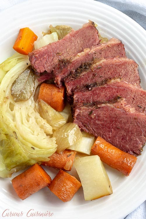 What is corned beef? Is corned beef Irish? Find out the history behind this St. Patrick's Day staple, and get our easy Corned Beef and Cabbage recipe. This is the only recipe you'll need to get perfect corned beef brisket every time! | www.CuriousCuisiniere.com