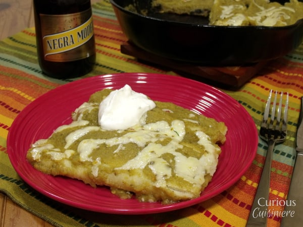 A spinach and black bean filling makes these quick and easy Skillet Spinach and Green Chili Enchiladas a hearty and nutritious weekday dinner recipe. |  Curious Cuisiniere