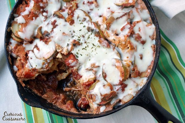 Overhead vegetarian lasagna with a portion removed.