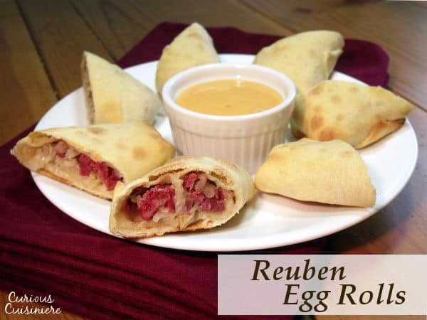 All the sandwich flavor in a little hand-held bundle, these Baked Reuben Egg Rolls are the perfect recipe for St. Patrick's day and beyond! | www.CuriousCuisiniere.com