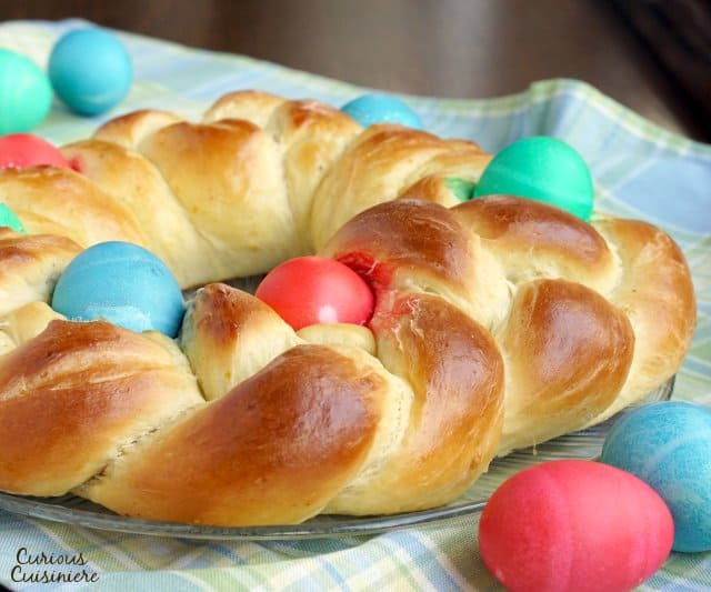 Italian Easter Bread, Pane di Pasqua, studded with brightly dyed easter eggs. | www.CuriousCuisiniere.com