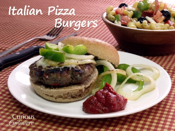 Italian spiced beef and all your favorite pizza toppings make this Pizza Burger recipe an out-of-this-world fusion in every bite! | Curious Cuisineire