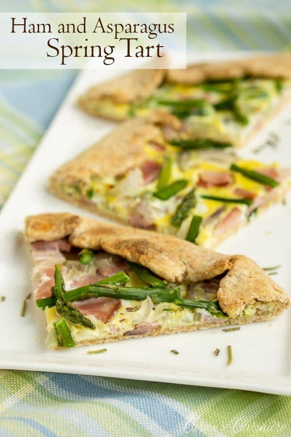 This Ham and Asparagus Tart is light and perfect for spring with strips of leftover ham and thin asparagus spears, roasted perfectly in a lemon herb crust. #spring #tart #asparagus | www.CuriousCuisiniere.com
