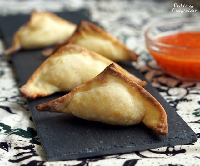 The perfect, crispy and creamy appetizer recipe, these Baked Crab Rangoon are a healthier way to satisfy your craving for Chinese takeout. | www.CuriousCuisiniere.com