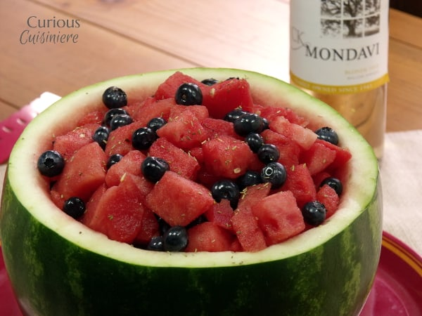 """Blueberries, watermelon, & white wine make this Red White and Blue Fruit Salad perfect for any summer picnic. Just keep it on the """"adults only"""" table!   Curious Cuisiniere #wine #summer"""