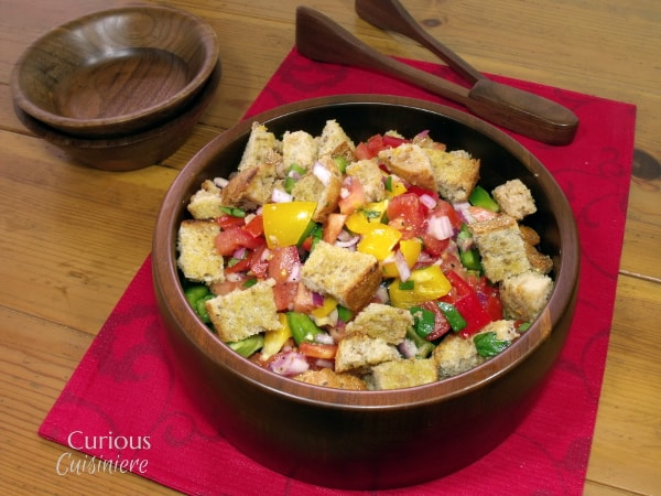 This take on Tuscan Bread Salad, or Panzanella, adds sweet peppers and red onions to the traditional dish of toasted bread and tomatoes. | Curious Cuisiniere #PicnicGame #SundaySupper