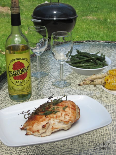 An oaky Chardonnay marinade gives this Grilled Chardonnay Chicken a depth of flavor that brings out the smokiness you crave from grilled meats. | Curious Cuisiniere #winePW #grilling