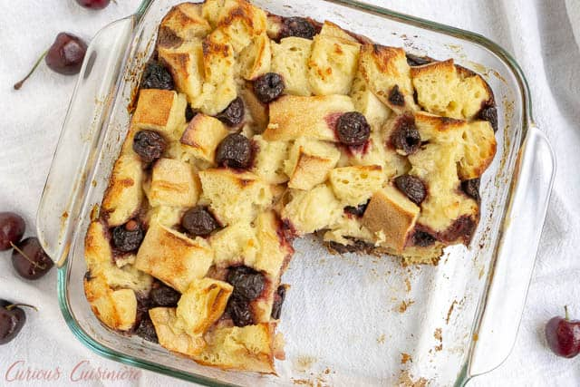 A balsamic glaze gives this cherry bread pudding an unexpected burst of bright flavor. This recipe is the perfect way to use stale bread and makes a wonderful breakfast or dessert! | www.CuriousCuisiniere.com