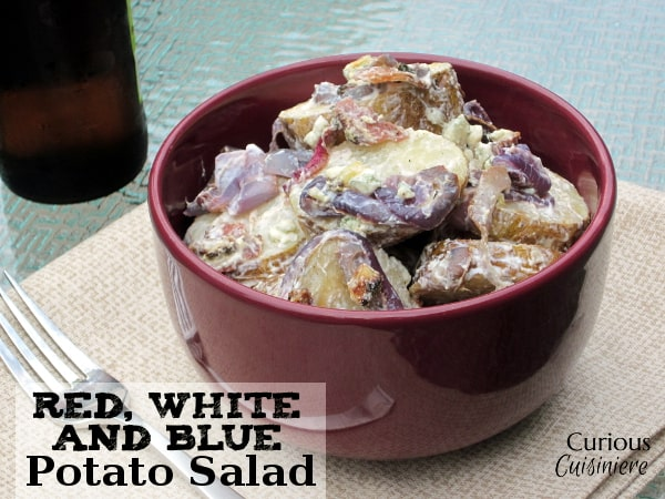 This healthy potato salad with yogurt, red onions, blue cheese, bacon, and roasted potatoes is big on creamy flavor but light on calories! | Curious Cuisiniere