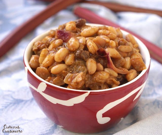 While unexpected, our Rhubarb Baked Beans are lightly sweet, slightly tart, and the perfect recipe for a light summer side dish. | www.CuriousCuisiniere.com