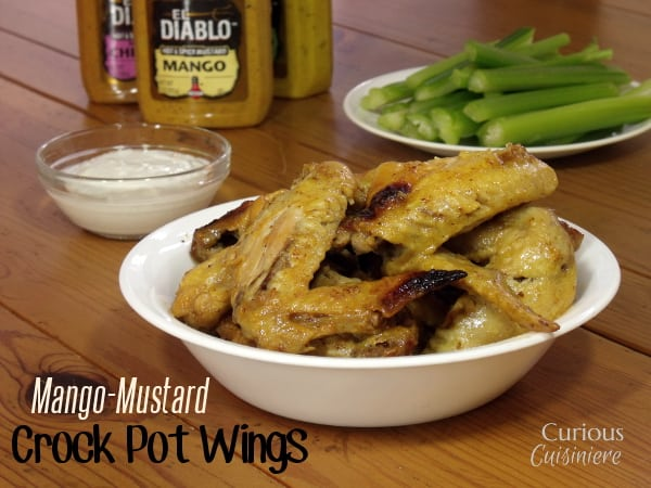 Sweet and Spicy Crock Pot Wings are incredibly simple to make. Use your favorite wing sauce, mustard, or spicy jam to make these crock pot wings your own!  -- Curious Cuisiniere