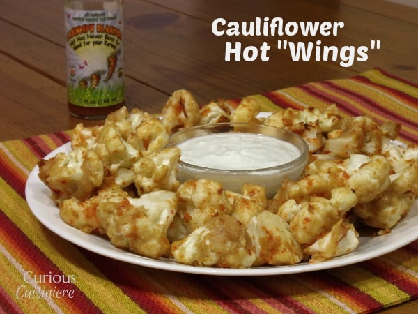 These cauliflower hot wings are a fun way to sneak veggies into your game day spread. Serve them with our healthy blue cheese dressing for a real crowd pleaser! - Curious Cuisiniere
