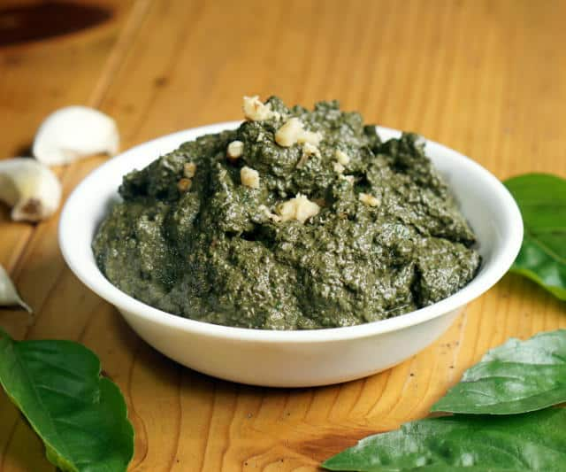You don't have to wait until summer's harvest to enjoy fresh basil pesto! This basic pesto recipe is perfect for freezing so you can enjoy it all year long. | www.CuriousCuisiniere.com