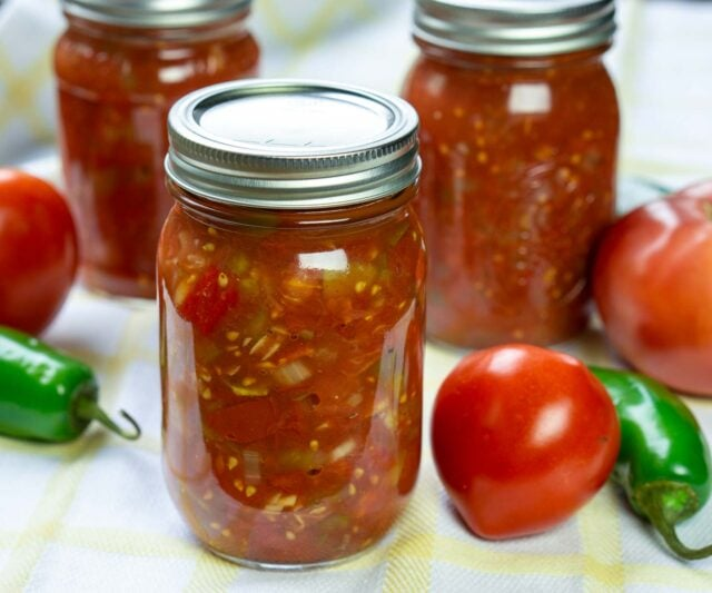 Tomato salsa for canning in jars with produce