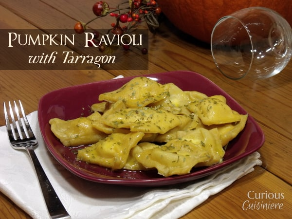 Pumpkin infused pasta makes the perfect vessel for a creamy tarragon-spiced cheese filling in this pumpkin ravioli recipe. | www.curiouscuisiniere.com