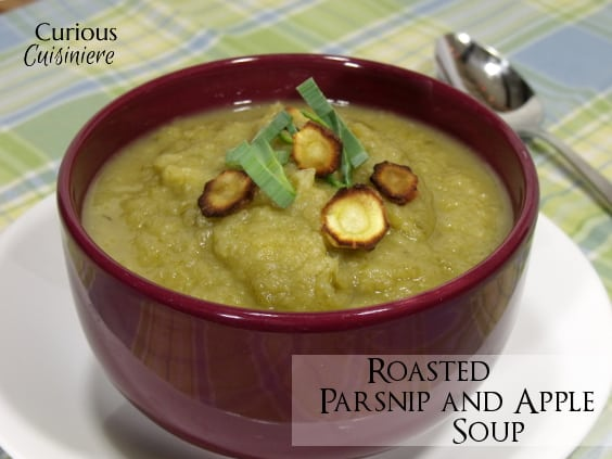 A slightly sweet and immensely comforting recipe for a fall soup, this Roasted Parsnip Apple Soup is sure to warm those cool fall days.  | www.CuriousCuisiniere.com