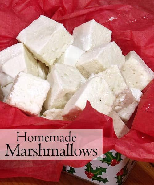 These homemade marshmallows are super fluffy and don't leave you tangled in a sticky, stringy mess. They're the perfect addition to winter hot chocolate! | www.CuriousCuisiniere.com