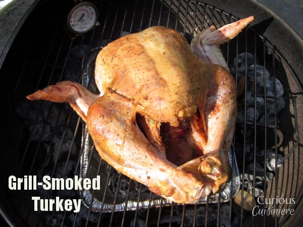 You don't need a smoker to get the great flavor and juicy meat of a Smoked Turkey. We'll show you how to make a smoked turkey on a charcoal grill! | www.CuriousCuisiniere.com