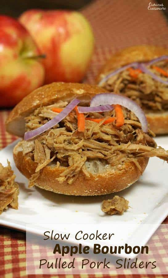 Apple adds sweetness to this slow cooker bourbon pulled pork. This dish makes for great appetizer sliders or an easy main meal! Double (or triple) the recipe to serve a crowd! | www.CuriousCuisiniere.com