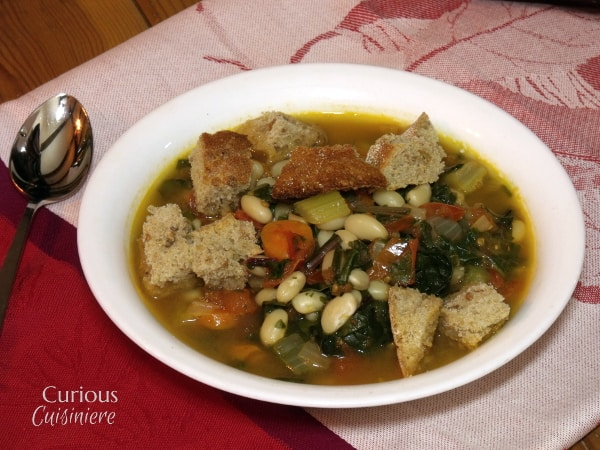 This hearty Tuscan Ribollita is a hearty vegetable aand bean stew that gets better the second day, so make up a big batch to have on hand for those cold winter nights! -- Curious Cuisiniere