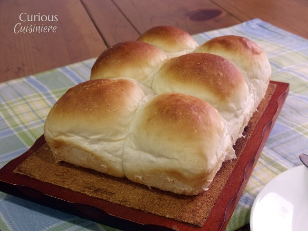 These light and fluffy dinner rolls are easy to make in the bread machine or by hand. Treat your family to something special! | Curious Cuisiniere