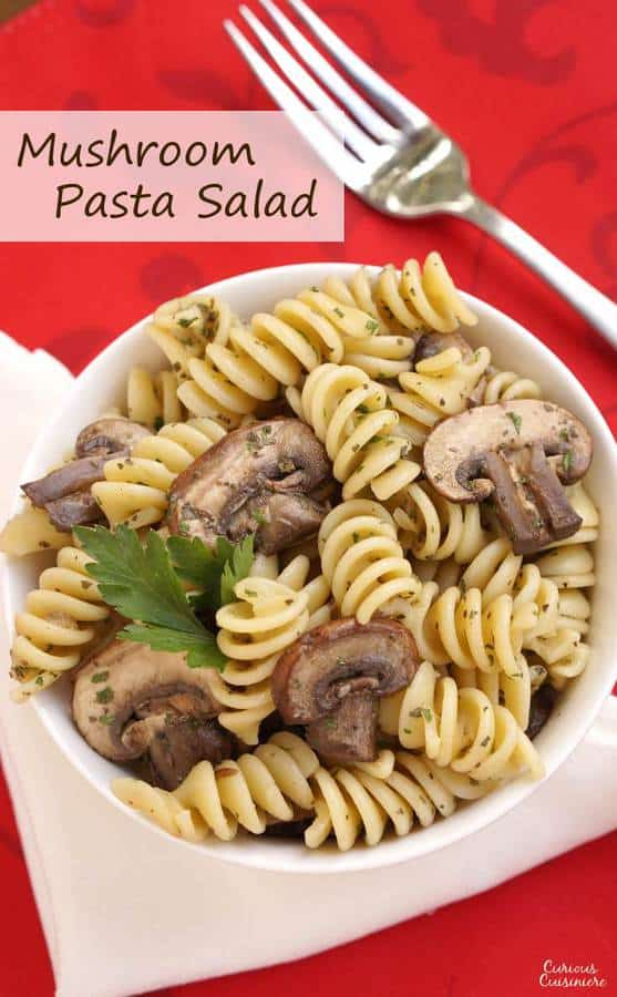 Herbs with a light vinegar dressing give this Mushroom Pasta Salad a bright but earthy flavor. Serve it hot or cold to suit the season. | Curious Cuisiniere