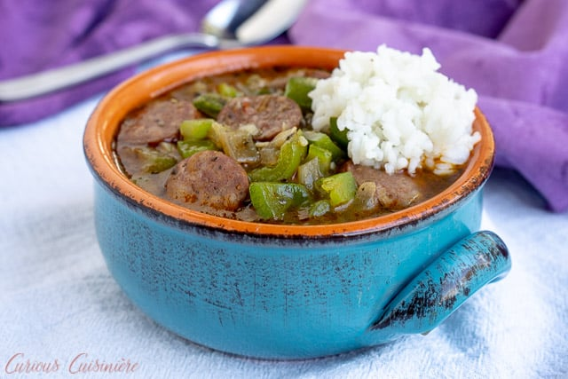 A bowl of Cajun gumbo with Andouille sausage and rice. | www.CuriousCuisiniere.com