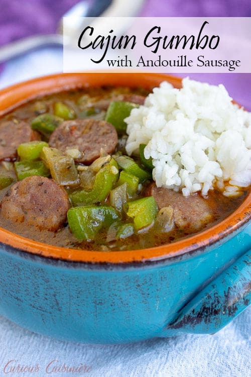 This recipe for Cajun Gumbo with andouille sausage is hearty and comforting. Serve it over rice for awarm and satisfying taste of the Louisiana bayou. | www.CuriousCuisiniere.com