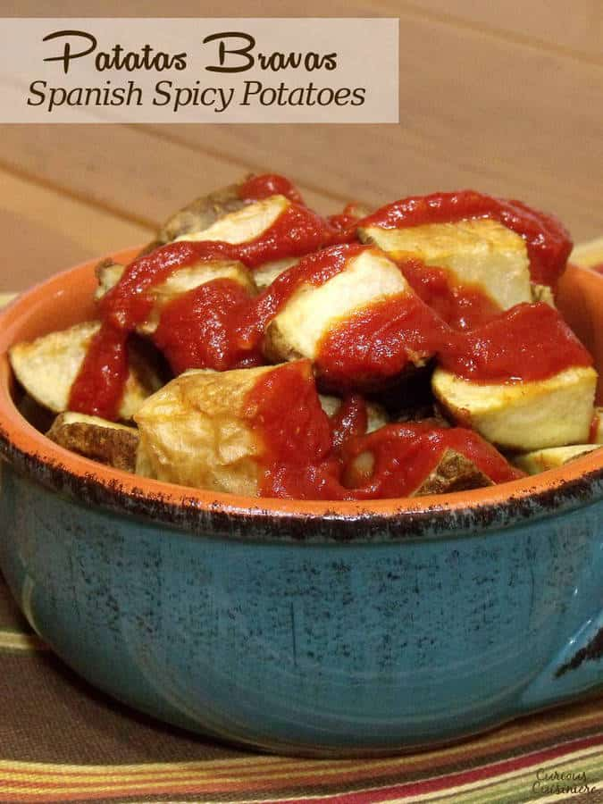We've lightened up Patatas Bravas, the traditional Spanish tapas dish, by roasting the potatoes and serving it with a traditional spicy tomato-based sauce. | www.CuriousCuisiniere.com