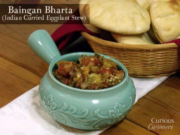 Baingan Bharta is a warming Indian eggplant stew that brings a medley of vegetables together with a smoky curry sauce for a dish that is delicious with rice or warm flatbread. -- Baingan Bharta (Indian Curried Eggplant Stew) from Curious Cuisiniere
