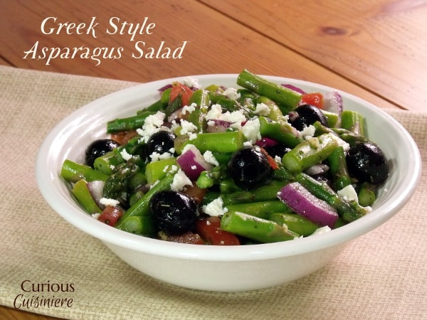 A lemony dressing mingles with crisp asparagus, black olives, and feta cheese in this Greek Asparagus Salad, a recipe that is perfect for spring. - Greek Asparagus Salad from Curious Cuisiniere