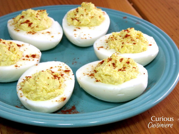 Creamy, mustard-y deviled eggs just make us think of Easter and spring. | www.CuriousCuisiniere.com