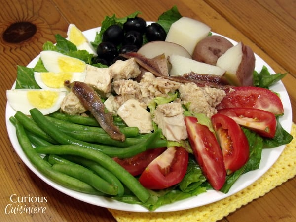 Salade Nicoise is a hearty, protein packed salad full of eggs, tuna, olives and veggies. Perfect for those chillier spring days. -- Salad Nicoise from Curious Cuisineire