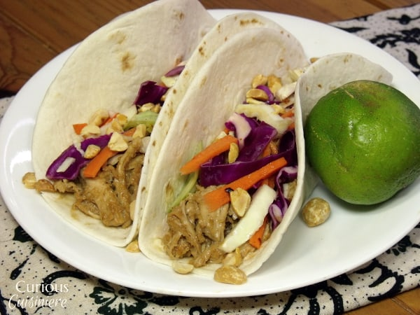 Leftover chicken is given new life with a nutty, Thai peanut sauce and a bright cabbage slaw. - Thai Peanut Chicken Tacos from Curious Cuisiniere