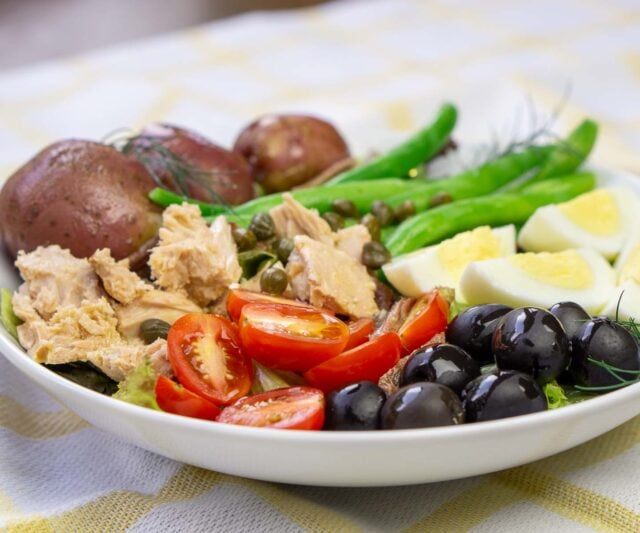French Salade Nicoise (Nicoise Salad) with boiled potatoes and anchovies