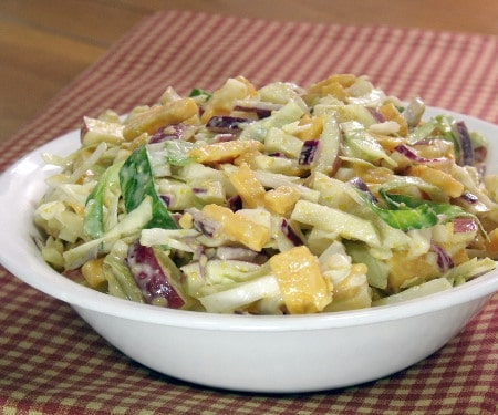 Smooth, sharp cheddar meets sweet, crisp apples in this flavor-explosion Cheddar Apple Slaw that is sure to be the star of your next cookout or game day party. | www.CuriousCuisiniere.com