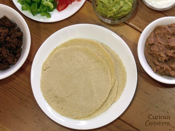 If you've ever wondered how to make corn tortillas from scratch, today is your day to stop wondering and start making! You are about to discover that there is NOTHING like a fresh tortilla.  | www.CuriousCuisiniere.com