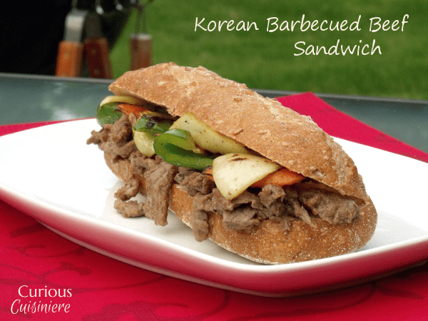 Tender beef steak marinated in a sweet Korean sauce makes this Bulgogi Sandwich anything but ordinary. | www.CuriousCuisiniere.com