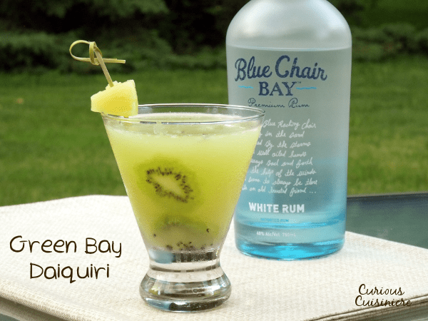 A green and gold take on the classic daiquiri, this pineapple and kiwi cocktail is perfect for your next summer party! | www.CuriousCuisiniere.com