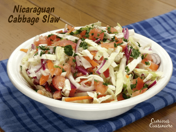 Try something new for your next BBQ or cookout with this crunchy Ensalada de Repolla. The Nicaraguan version of Coleslaw is bright and flavorful with a lime and cilantro vinaigrette.| www.CuriousCuisiniere.com