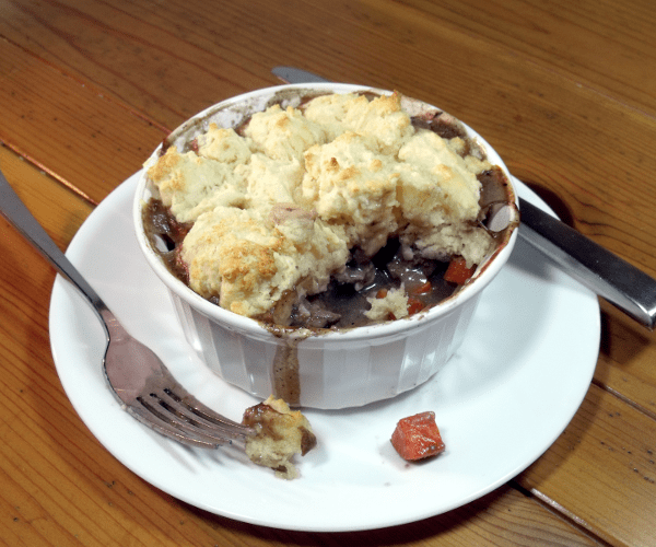 Beef Burgundy is a classic French winter stew. We've turned the classic stew into individual serving pot pies.