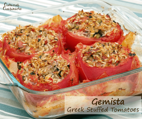 Greek Gemista brings big juicy tomatoes together with a healthy, vegetarian mixture of rice and summer produce, creating a perfect summer dish. | Curious Cuisiniere