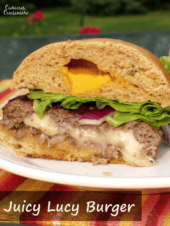 Cheese lovers rejoice! This Juicy Lucy Burger is stuffed with gooey cheese. It's the perfect addition to any summer barbecue or cookout. Fire up the grill! | www.CuriousCuisiniere.com