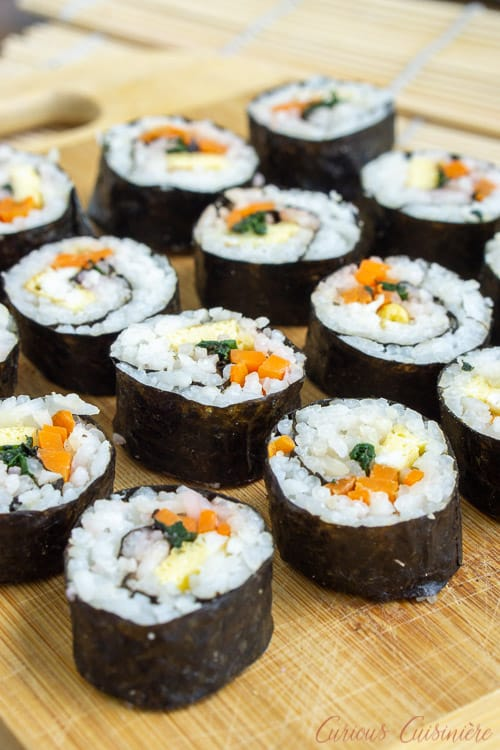 Kimbap (or gimbap) could be called Korean sushi, and if you are a fan of sushi, you are going to love the light and slightly nutty flavor of these rolls. They're the perfect recipe for summer picnics and lunches!  | www.CuriousCuisiniere.com