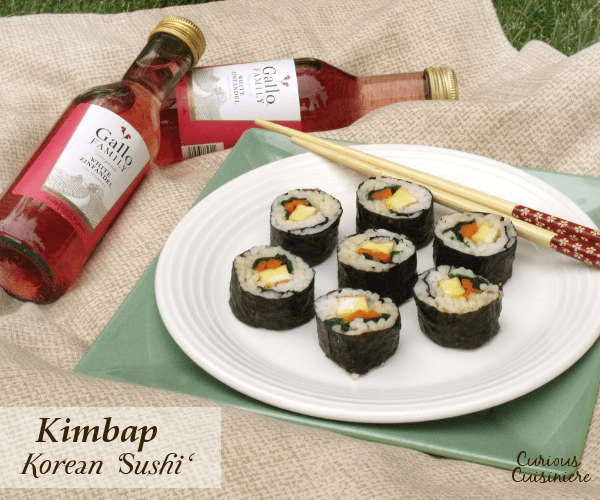 Similar in style to Japanese sushi, Korean Kimbap has a mildly nutty flavor and are packed with veggies, eggs, even cooked meats. They are perfect to pack along for a summer picnic! #SundaySupper