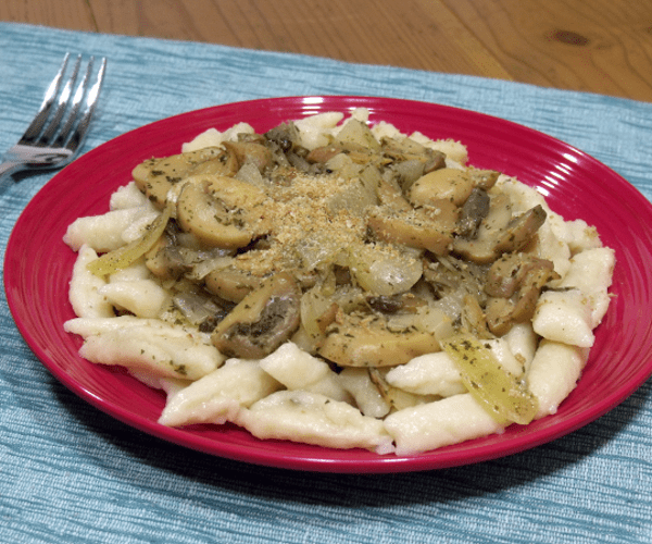 The Polish version of Italian gnocchi. Soft and fluffy potato dumplings delicious topped with cheese or mushrooms.