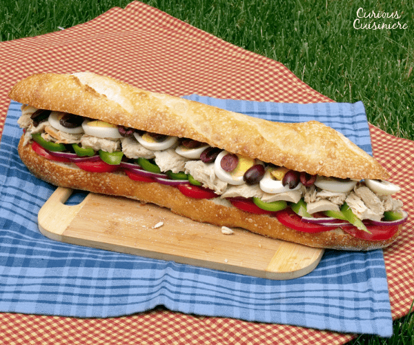 The Pan Bagnat is the French take on a tuna sandwich that is perfect for packing up for your next summer picnic. | www.CuriousCuisiniere.com