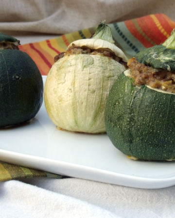 Cute round zucchini are stuffed with a mixture of herbs and sausage. How can you go wrong with zucchini this cute?